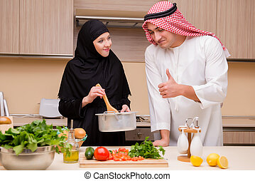 Young arab family in the kitchen