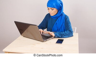 Young arabian woman using laptop - Young pretty arabian...