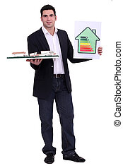 young architect holding model shows energy rating house
