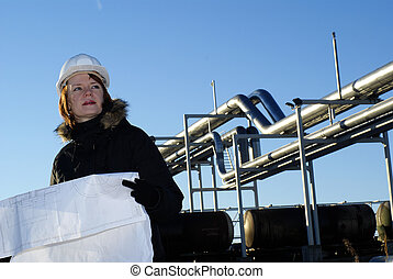 Engineer holding helmet for working at footing of building young architect looking at blueprint in front of construction site against blue sky malvernweather Images