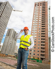 Young architect standing at building site