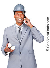 Young architect wearing a hardhat on phone