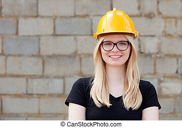 Young architect with yellow helmet