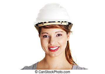 Young architect woman wearing a protective helmet
