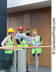 Young architects studying a building