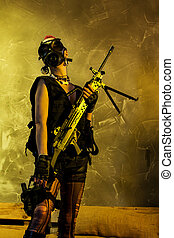 Young army woman holding an assault rifle