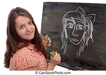 Young artist with black board and colored chalk