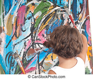 Young Artist - Young girl pretending to paint in front of an...