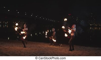 Young artists juggling staves during dance outdoor -...