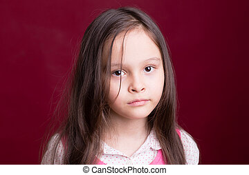 Young Asian American girl on red background