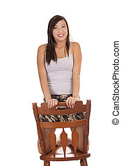 Young Asian American Teen Girl Kneeling on Chair