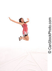 Young Asian American teen woman jumping red dress
