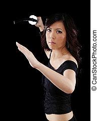 Young Asian American Woman Brandishing Japanese Sword