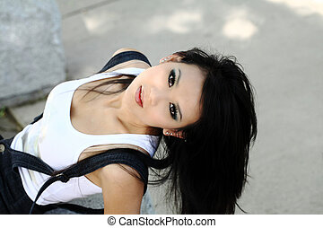 Young asian american woman from above horizontal