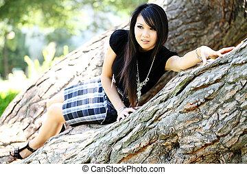 Young Asian American woman in oak tree dress
