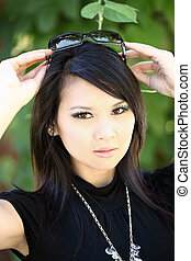 Young Asian American woman outdoor portrait sunglasses