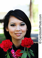 Young Asian American woman portrait with roses