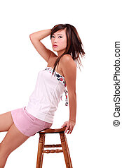 Young Asian American Woman Sitting on Stool