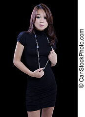 Young Asian American Woman Standing Black Dress