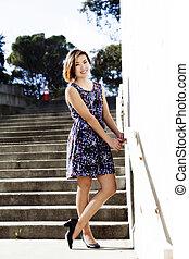 Young Asian American Woman Standing In Dress Outdoors