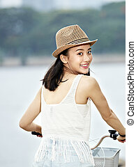 young asian bicycle rider