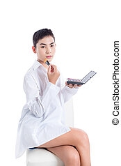 Young asian boy applying brush on over white background