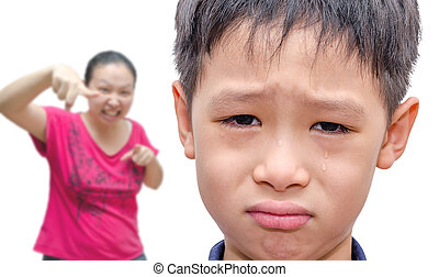 boy crying while mother scold him