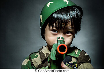 Young asian boy dressed like a soldier