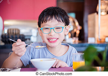 boy eating cereal for breakfast