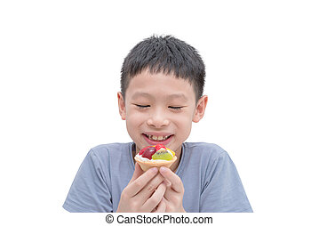 boy eating fruit tart over white