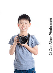 Young asian boy holding camera over white background