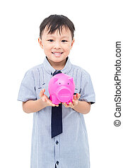 Young asian boy holding piggy bank over white background