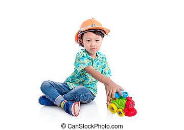 Young asian boy playing toy on the floor