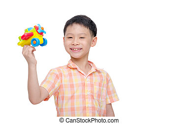 boy playing with plastic plane over white