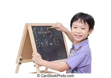 boy smiling between writing math answer