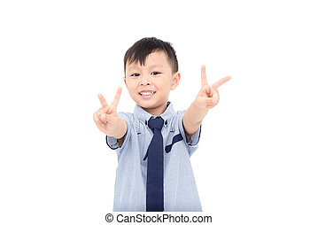 Young asian boy smiling over white background