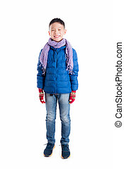boy wearing blue jacket and scarf standing over white background