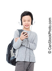 Young asian boy with backpack and headphone over white