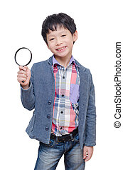 boy with magnifying glass over white