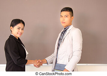 Young Asian business deal