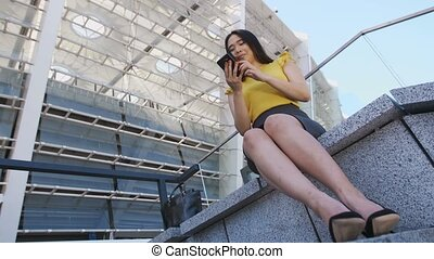 Young asian business girl using mobile phone