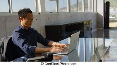 Young Asian business male executive working on laptop in office 4k