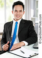 young asian business man at the office - Happy handsome...