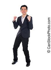 young asian business man celebrating success