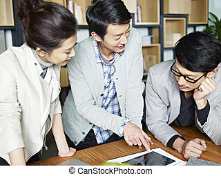 young asian business people working together in office