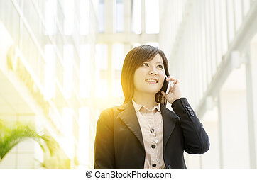 Young Asian business woman on the phone