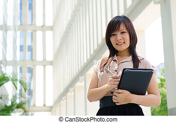 young asian business woman with office background