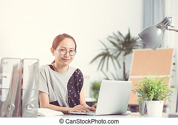 Young asian business woman working with computer .