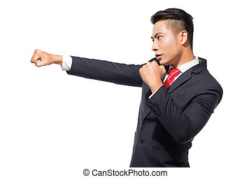 Young asian businessman ready to fight isolated on white