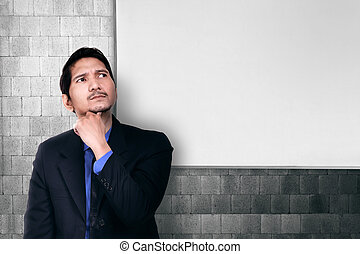 Young asian businessman thinking for solution
